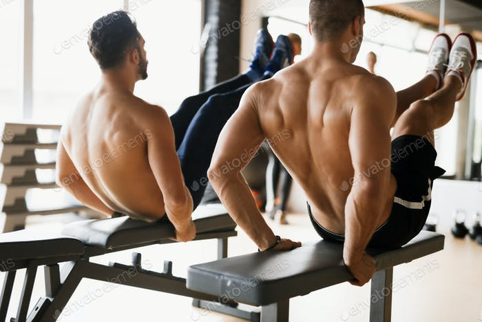 Guys working out together in gym
