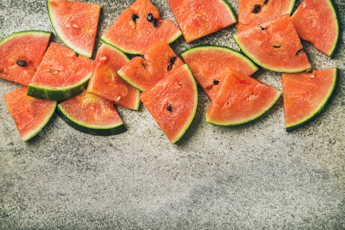 Juicy watermelon pieces over concrete stone background