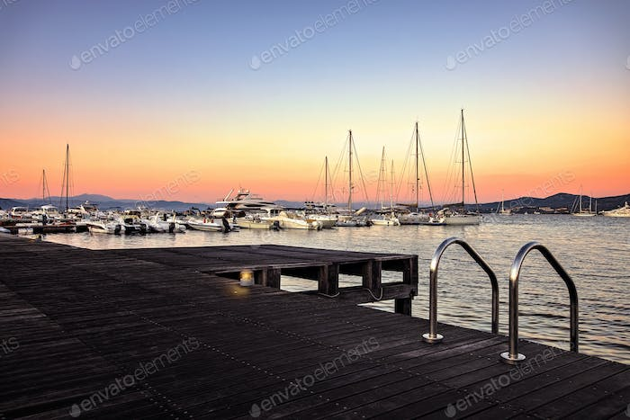 Landscapes from Sardinia by Italy,  on the Background the Portisco Harbor