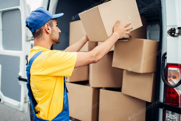 Cargo delivery service, male courier unload truck