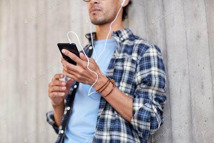 Thumbnail for man with earphones and smartphone listening music