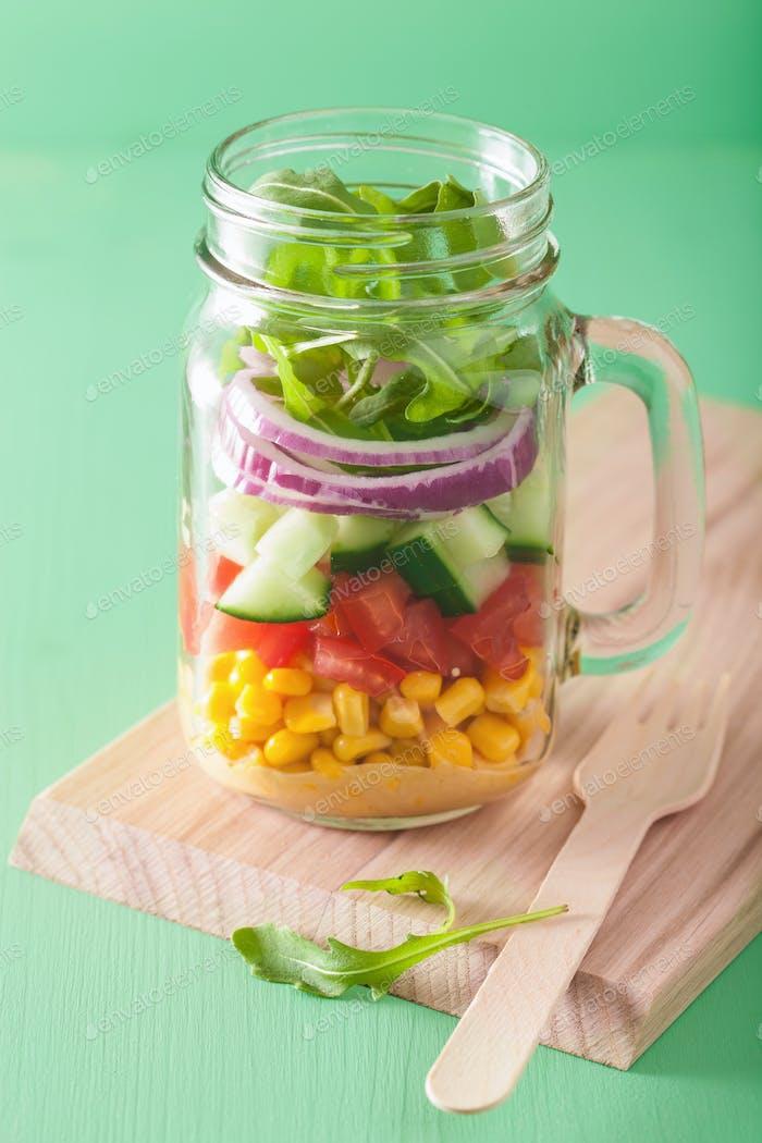 healthy vegetable salad in mason jar
