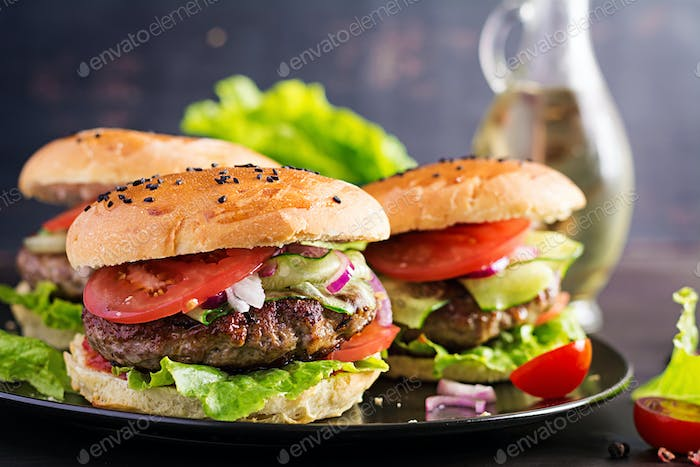 Big sandwich - hamburger burger with beef,  tomato,  red onion and lettuce.