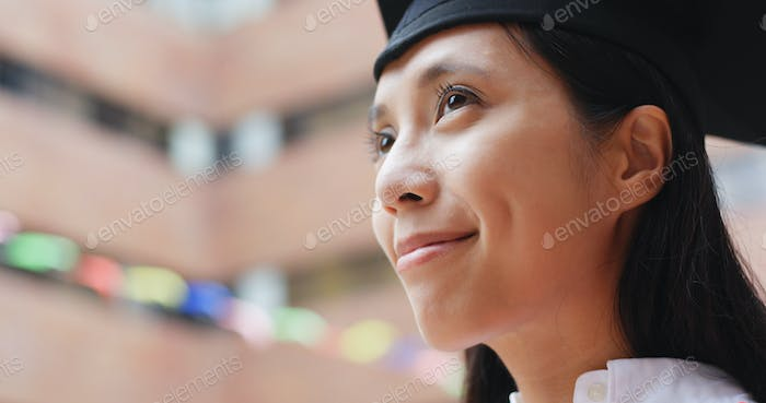 Woman get graduation and think of something