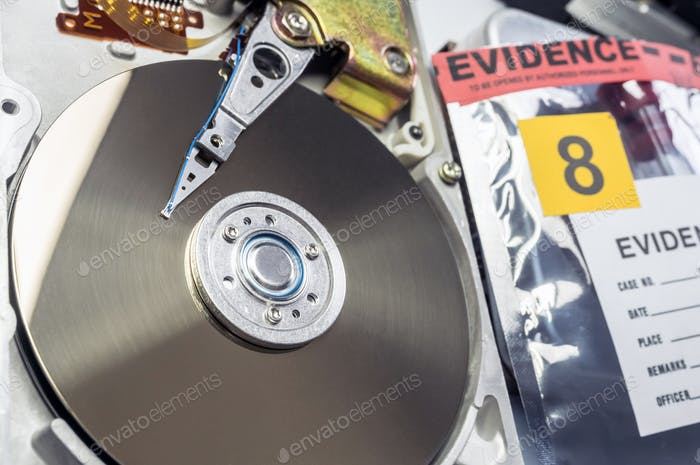 Hard disk opened in criminological laboratory, conceptual image