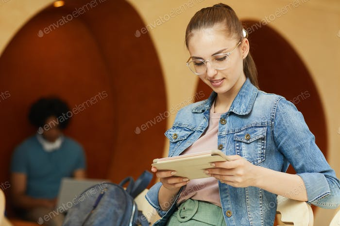 Student surfing net on tablet