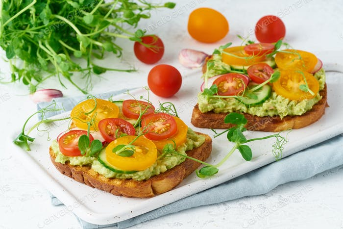 avocado toast with cherry tomatoes and herbs, breakfast, closeup