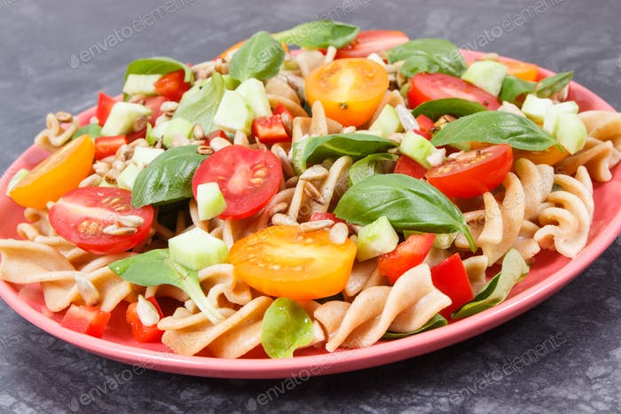 Fresh salad with wholegrain pasta and vegetables. Healthy lifestyles and nutrition