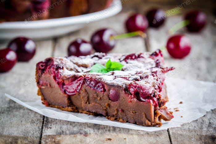 a piece of chocolate cake Clafoutis with cherries