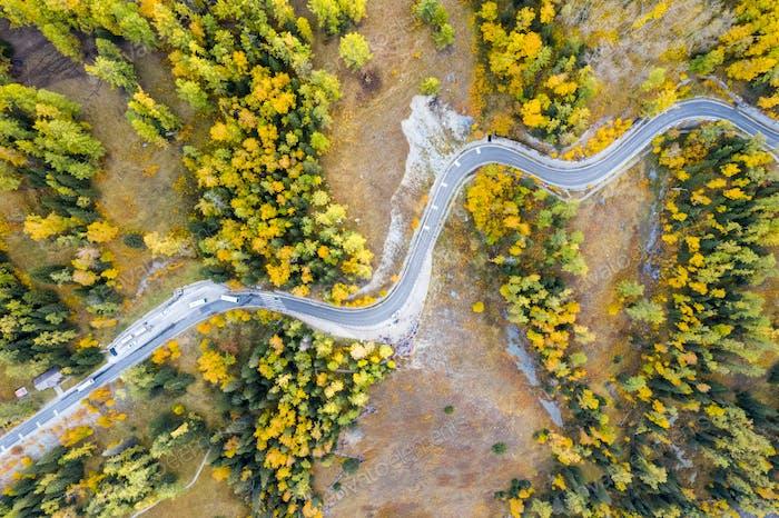 aerial view of autumn winding mountain road,xinjiang kanas, China