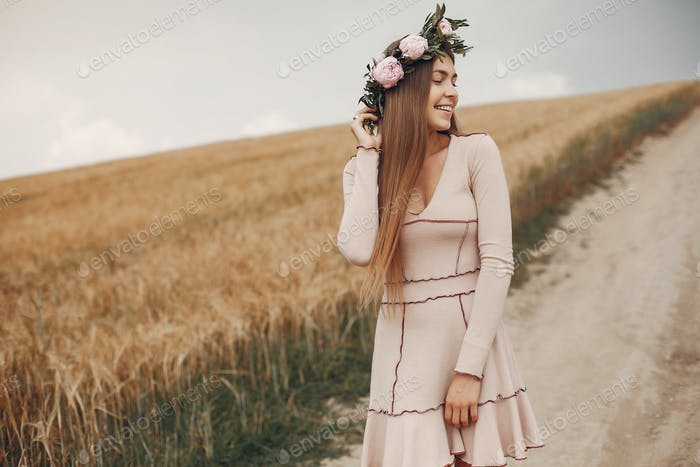 Elegant and stylish girl in a summer field