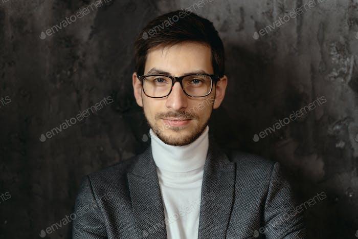 Portrait young, confident businessman wearing glasses