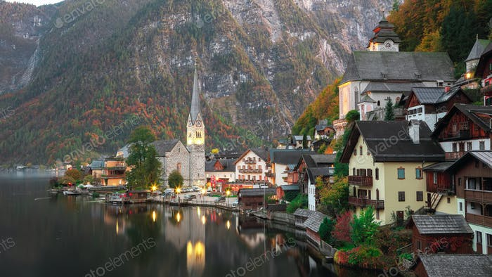 view of famous Hallstatt lakeside town reflecting in Hallstattersee lake in the Austrian Alps