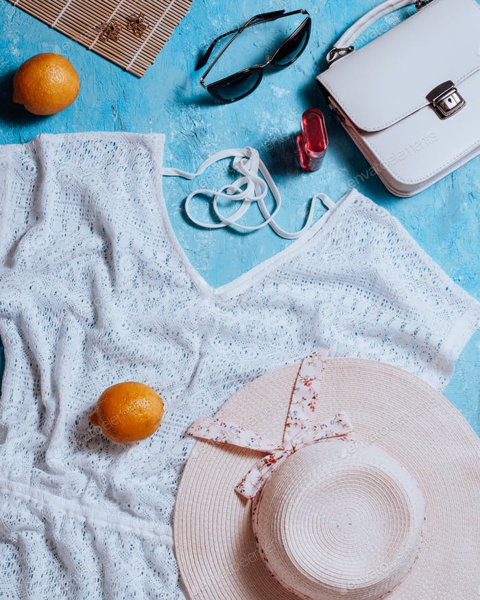 Woman fashion flat lay with clothing and accessories