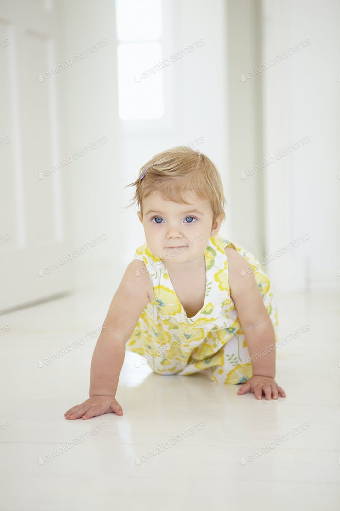 Thumbnail for Young Girl Crawling On Floor In Bedroom