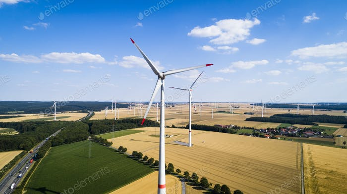 Aerial view of windmill against blue sky