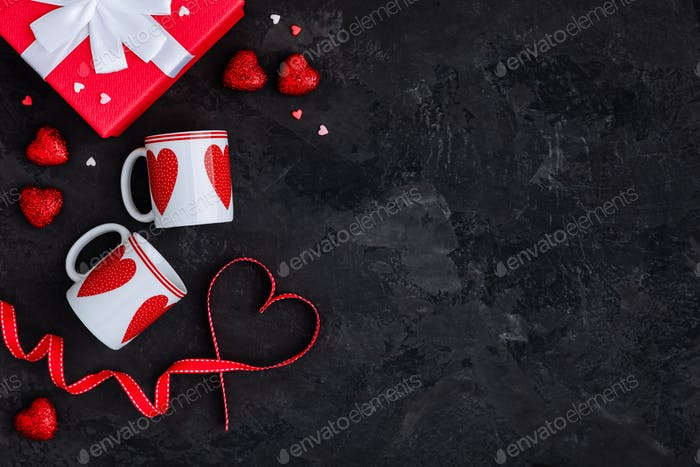 Valentines Day background with two cups, present box and red ribbon with heart and present box