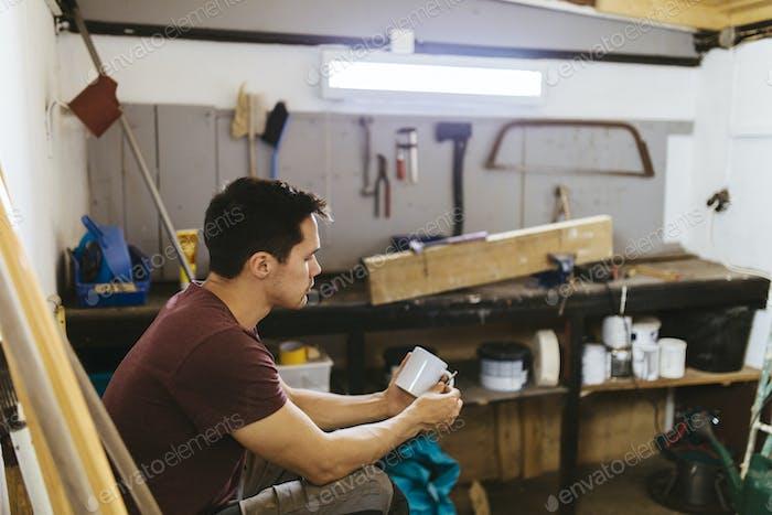 Man sitting in garage