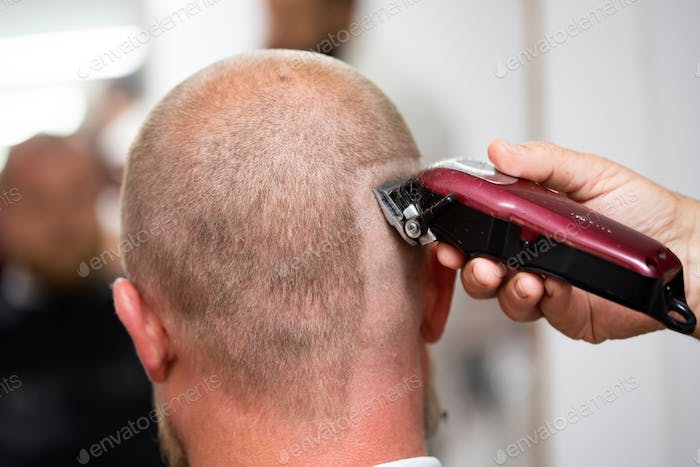 Man visiting hairstylist in barber shop.