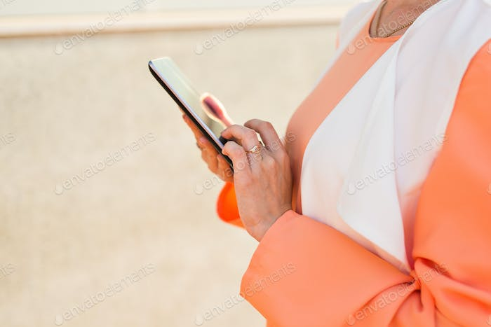 Closeup of muslim woman with tablet computer outdoors