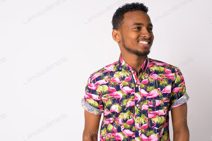 Happy young handsome African tourist man thinking