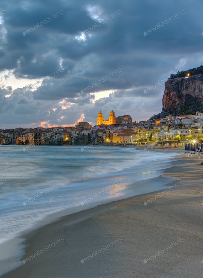 The beach of Cefalu before sunrise