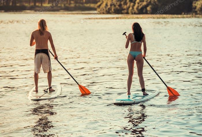 Couple standup paddleboarding