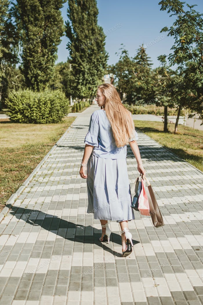 Summer sale, summer shopping, Consumerism, shopaholic, lifestyle. Young blonde happy woman with