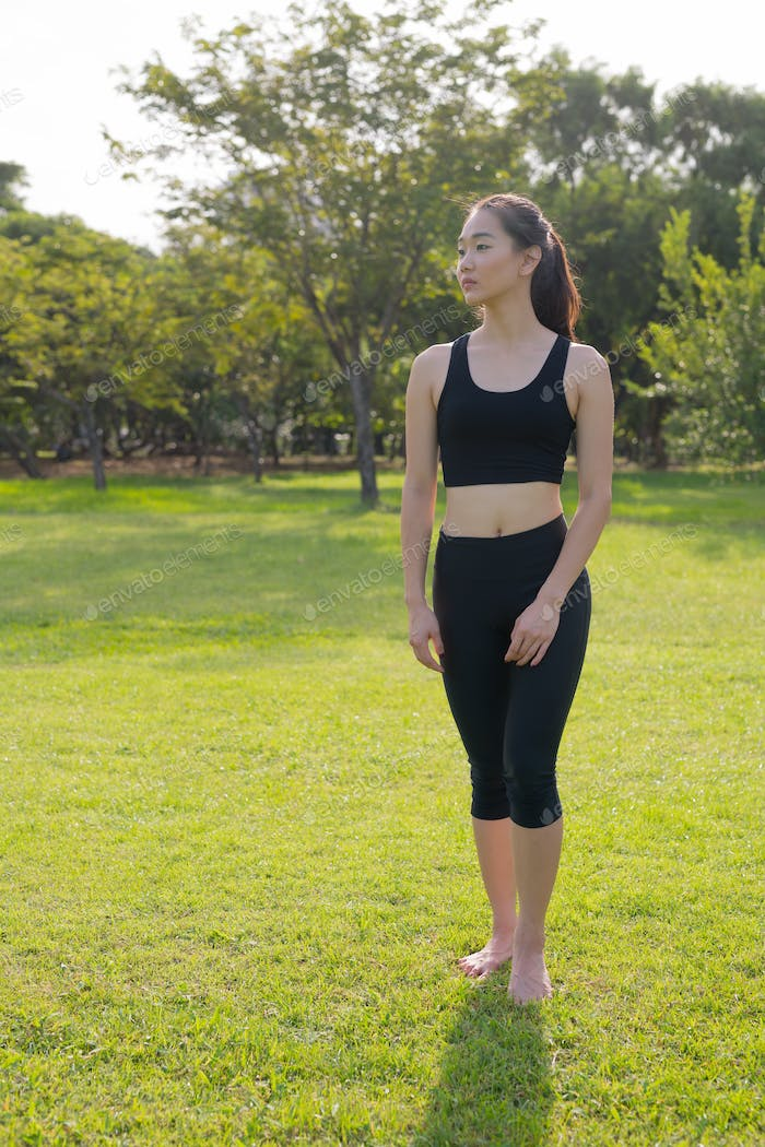 Full Length Portrait Of Asian Woman Ready For Exercise In Park