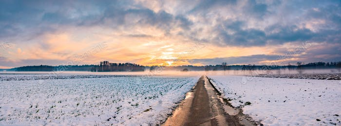 Landscape panorama with road, white fields