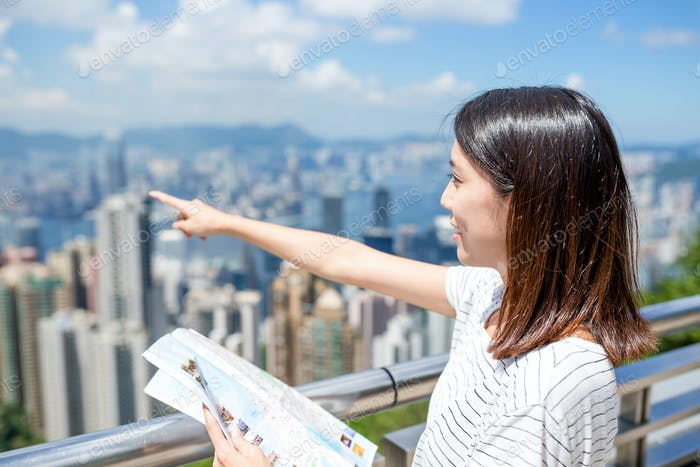 Woman travel in Hong Kong city with city map