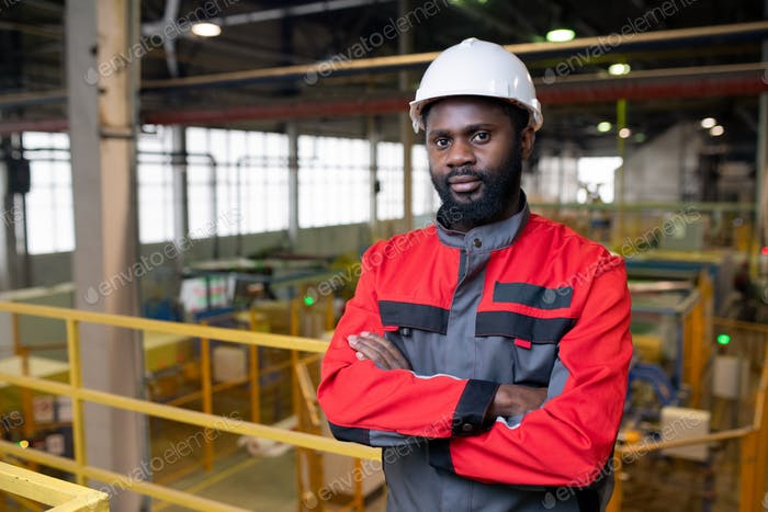 Afro-American factory worker in hardhat