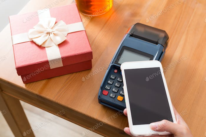 Pay money on POS machine for buying gift