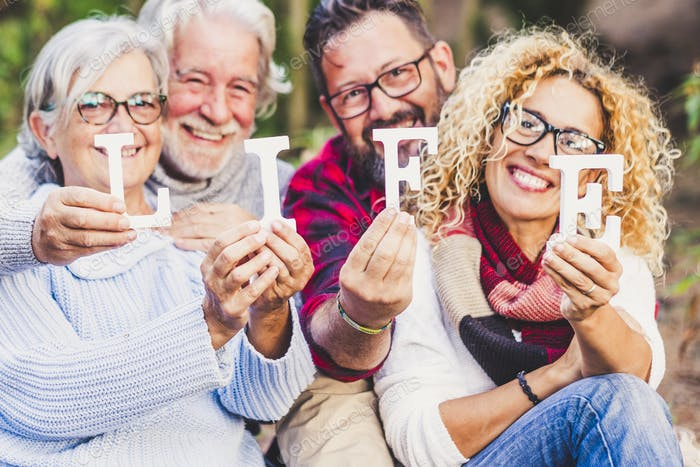 Group of mixed ages people celebrate life