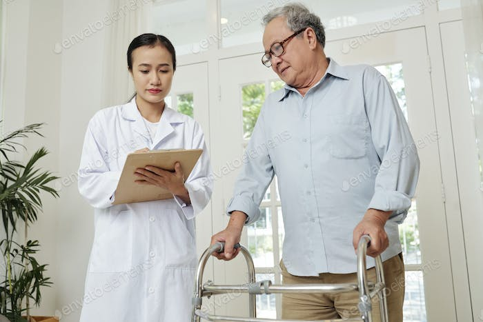 Doctor controlling the health an elderly patient