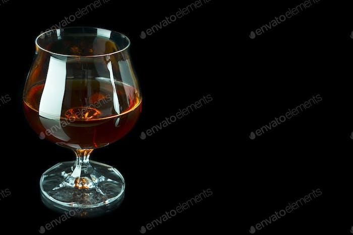 Scotch drink on black background