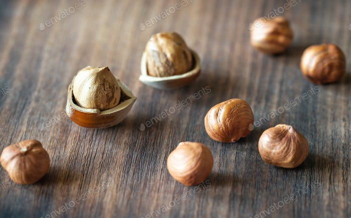Hazelnuts on the wooden background
