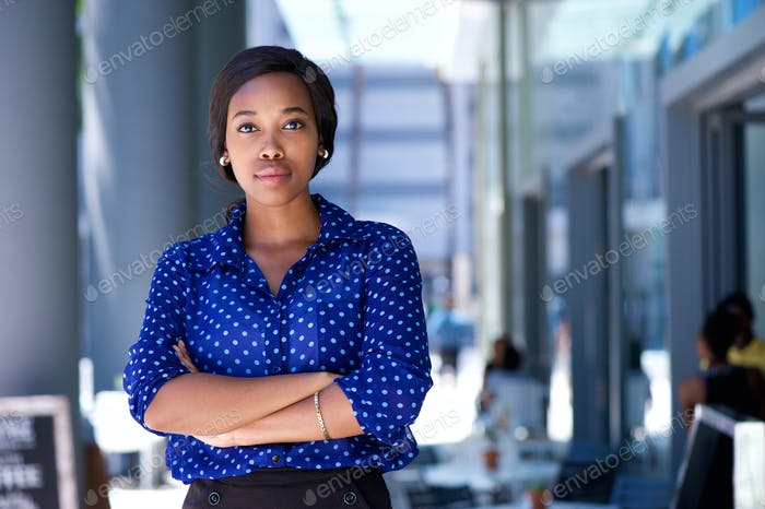 Confident young african american woman standing in the city