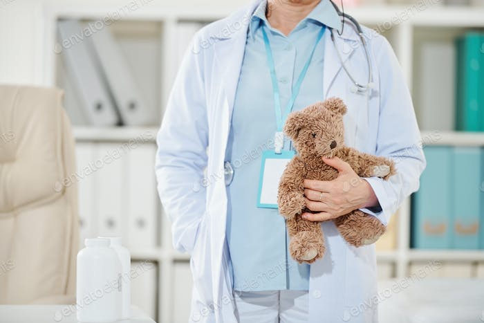 Pediatrician holding teddy bear