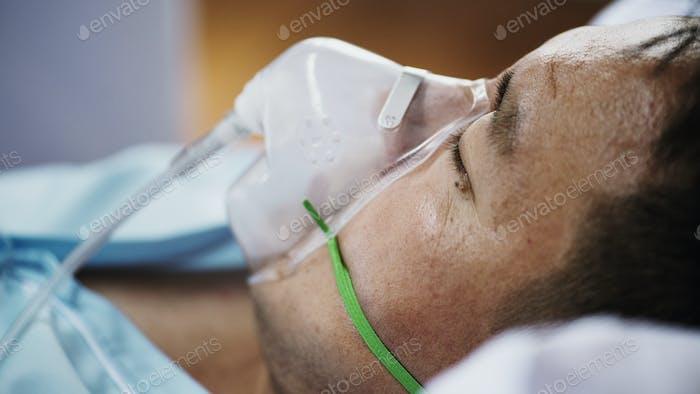Coronavirus patient wearing an oxygen mask