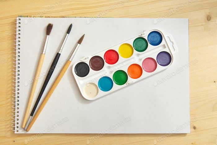 Paint brush and album.