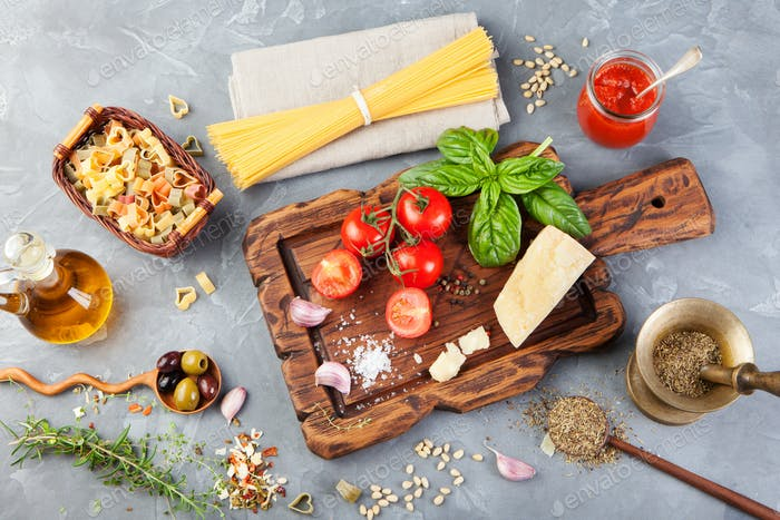 Thumbnail for Italian food background with vine tomatoes, basil, spaghetti, olives, parmesan, olive oil, garlic