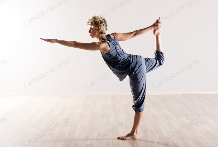Woman in perfect balance while holding foot