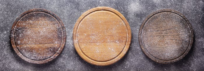 Scatterd flour powder food and pizza cutting board as bakery concept for homemade bread baking