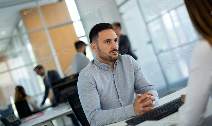 Portrait of a young business man looking depressed and worried from work
