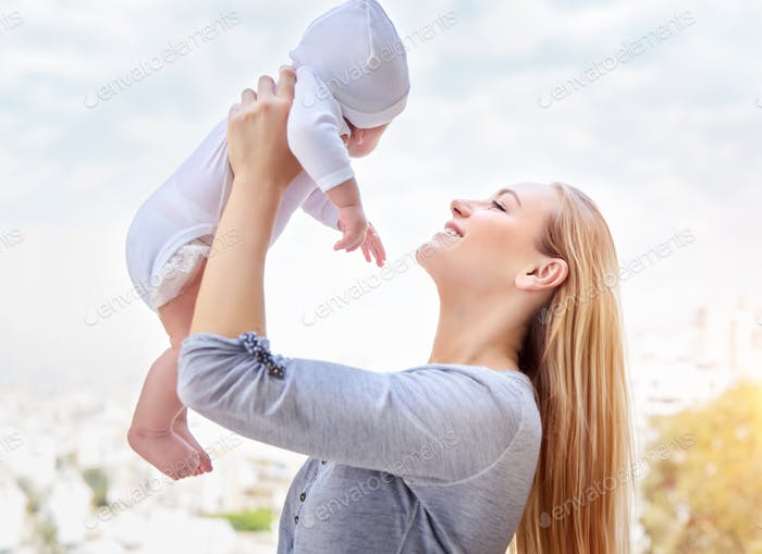 Happy mother with baby