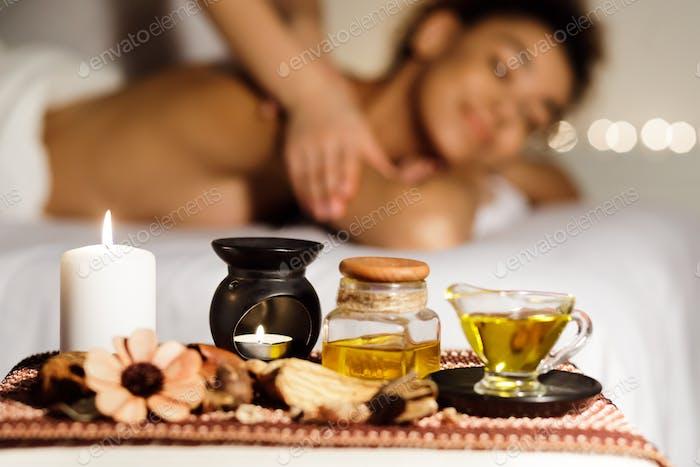 Aroma massage. Relaxed lady enjoying back massage