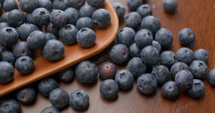 Stack of blueberry on the wooden plate