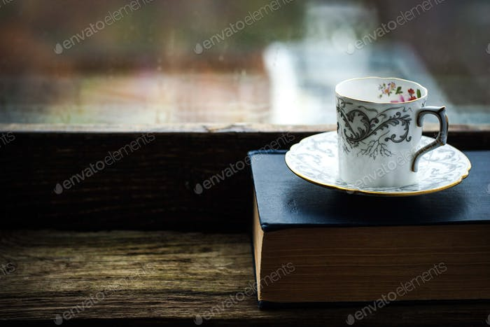 Coffee cup  with old book