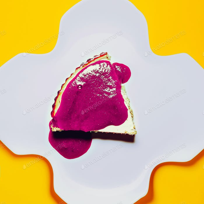 Design photo. Crimson cake on yellow background